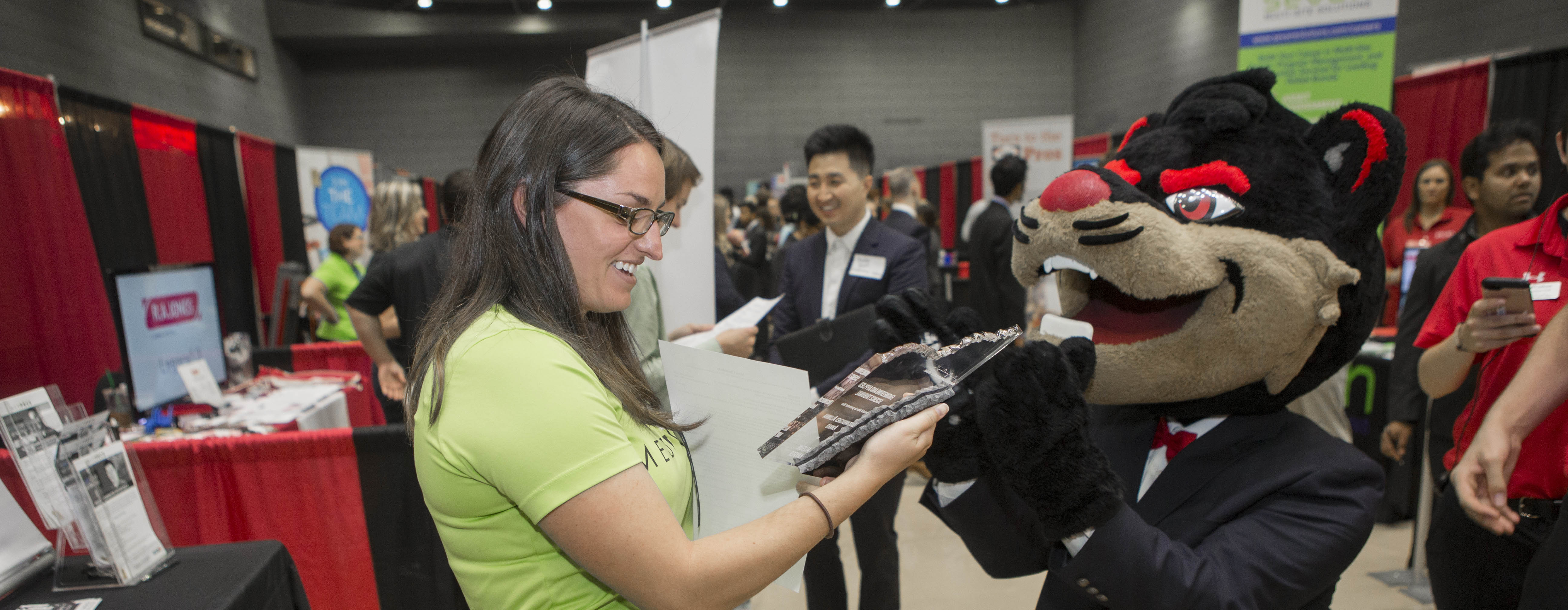 The Bearcat talking to an employer at the Career Fair.